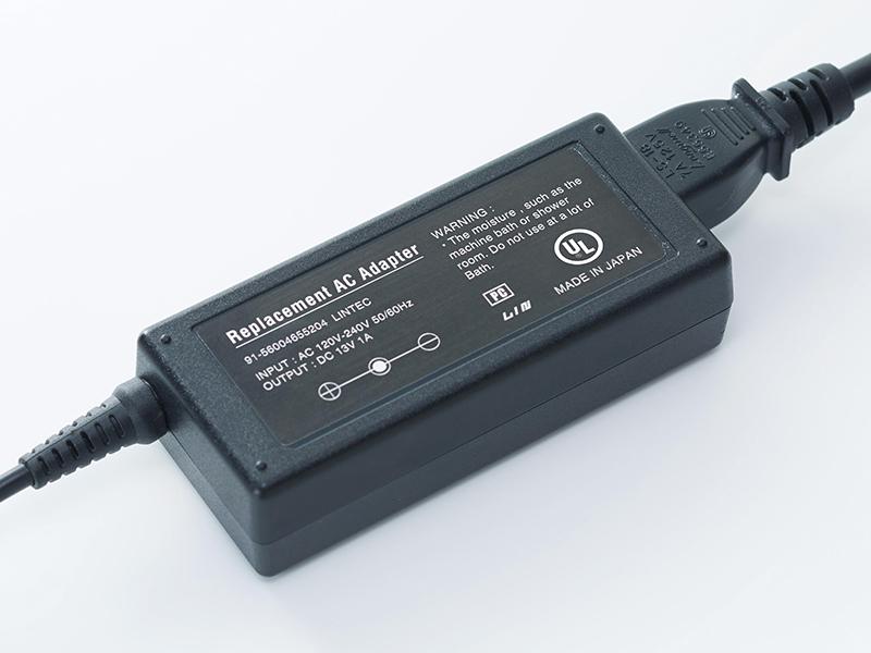 Bubble Free label on power adaptor